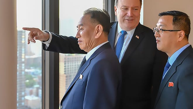 This handout photograph, obtained courtesy of the U.S. State Department, shows Kim Yong Chol (left), Vice Chairman of North Korea, during his meeting with Secretary of State Mike Pompeo (center).
