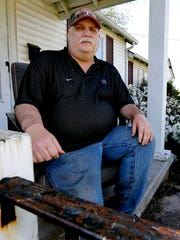 Mark Gunn on his porch at his Smyrna home on Tuesday,