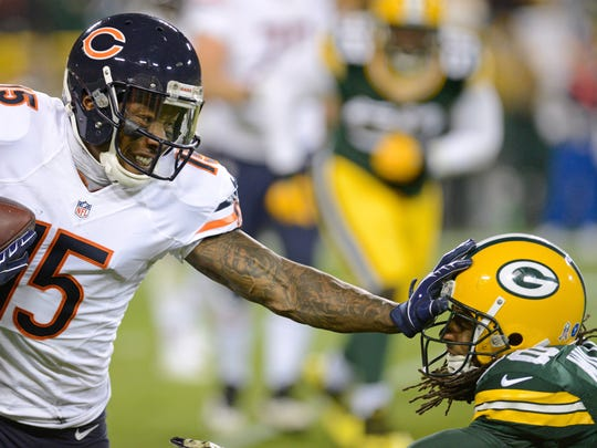 Chicago Bears wide receiver Brandon Marshall (15) stiff arms Green Bay Packers cornerback Tramon Williams (38) in the second quarter.