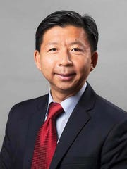 XinQi Dong, director of Rutgers University's Institute
