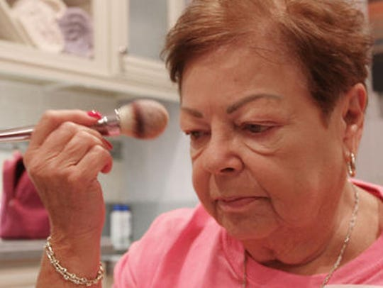 Dorothy Hultz of Lakewood applies makeup.