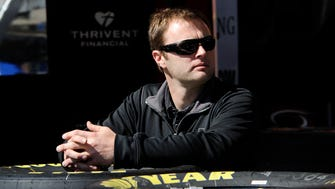 NASCAR driver Travis Kvapil waits in the the garage at Atlanta Motor Speedway Friday, Feb. 27, 2015, in Hampton, Ga. Kvapil's NASCAR Sprint Cup car was stolen early Friday, forcing him to withdraw from a race this weekend at Atlanta Motor Speedway.