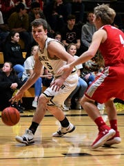 Haskell's Kyler Hoover tries to drive around Albany's