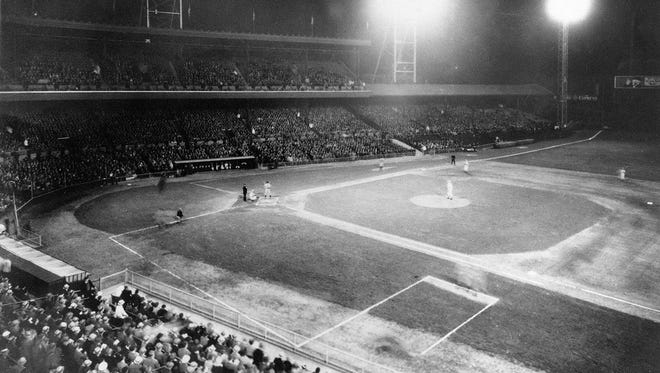 Cincinnati's Crosley Field hosts MLB's first night game in 1935.