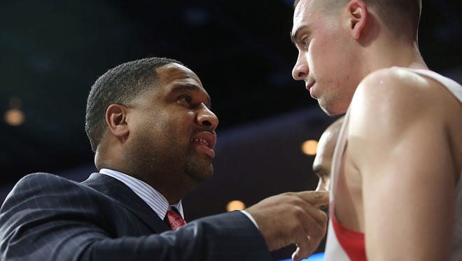 Assistant coach Book Richardson talks to Arizona Wildcats guard T.J. McConnell (4) in the second half during a game against ASU at McKale Center. Arizona won 79-43. Photo taken: Sunday January 04, 2015