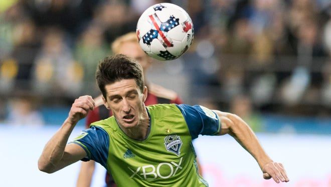 Sounders midfielder Alvaro Fernandez heads the ball against Atlanta United during the second half Friday night at CenturyLink Field. The game ended in a 0-0 draw.