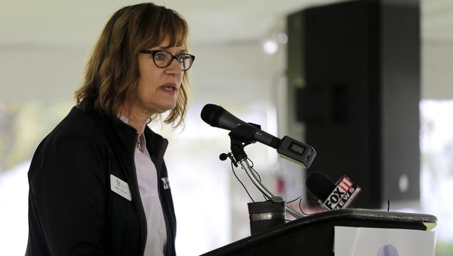 Harbor House executive director Beth Schnorr speaks during a recent groundbreaking ceremony for the Harbor House expansion in Appleton.