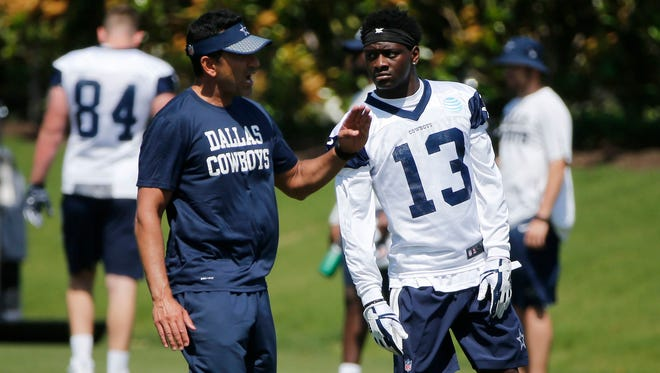 Former CSU star Michael Gallup listens to instructions from Dallas Cowboys receivers coach Sanjay Lal during a rookie minicamp Friday in Frisco, Texas. Gallup was selected by the Cowboys in the third round of the NFL draft as a potential replacement for star Dez Bryant, who was released in April.