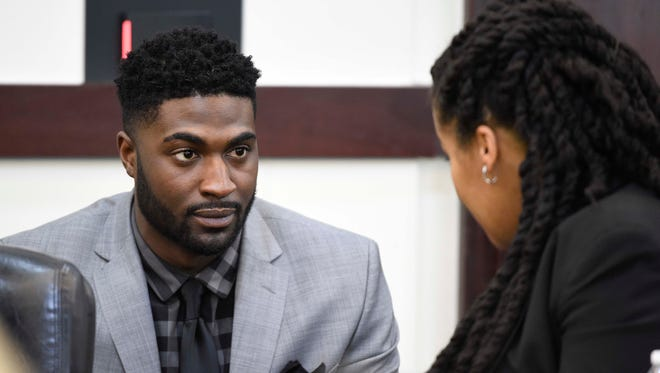 Cory Batey talks with his attorney Courtney Teasley during the opening day of Batey's retrial in Nashville.