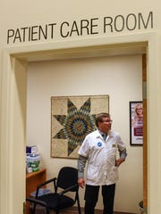 Little Falls Coborn's Pharmacy Manager Gary Sperl talks about the patient care room at the pharmacy Thursday, Sept. 28, in Little Falls.