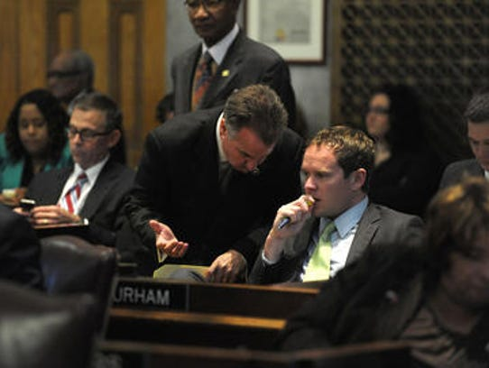 Rep. Jeremy Durham (seated) announced Sunday he will