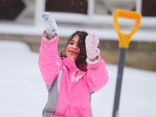 Daniella Dejesus, 5, of York City, plays in the snow