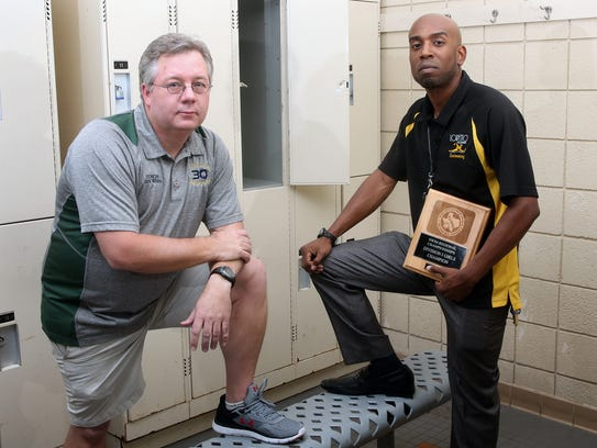 White stanton named swimming coaches of the year for Eastwood high school swimming pool