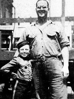 """Four-foot-tall """"Little Johnny"""" is shown with 250-pound Charles Chester Stine during a visit to York Corporation during World War II."""