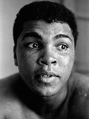 FILE - In this May 25, 1965 file photo, perspiration beads on the face of world heavyweight boxing champion Muhammad Ali during training for his fight with Sonny Liston, in Lewiston, Maine. Ali, the magnificent heavyweight champion whose fast fists and irrepressible personality transcended sports and captivated the world, died on Friday, June 3, 2016, according to a statement released by his family. He was 74.