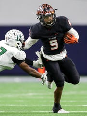 Aledo running back Jase McClellan (9) tries to get past Mesquite Poteet cornerback Isaiah Eiland (17) during the first half of the 5A Division II state semifinal on Dec. 9 at hte Ford Center in Frisco.