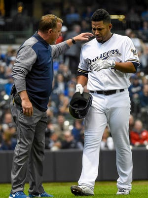 Brewers pitcher Junior Guerra speaks with trainer Dan Wright after an injury forced Guerra to leave the game in the third inning Monday against the Rockies at Miller Park.