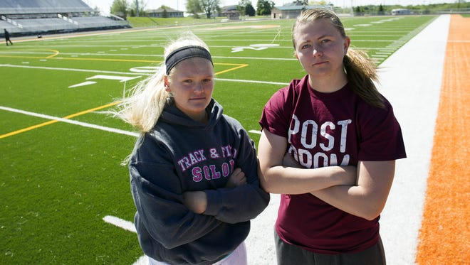 Solon throwers Katy Misel, left, and Shelby Gunnells pose for a photo on Monday, May 18, 2015.   David Scrivner / Iowa City Press-Citizen