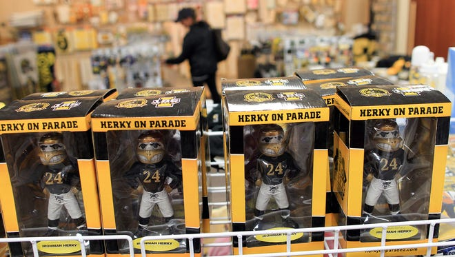 Miniature Herky statutes are seen for sale at Game Day Iowa in Coralville on Friday, Oct. 2, 2015. Owner Ron Christensen has decided to retire and close down the 25-year-old business in December.