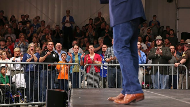 Spectators listen as Sen. Ted Cruz speaks to a crowd of about a thousand during a rally at the Boone County Fairgrounds, Lebanon, Ind., Saturday, April 23, 2016.