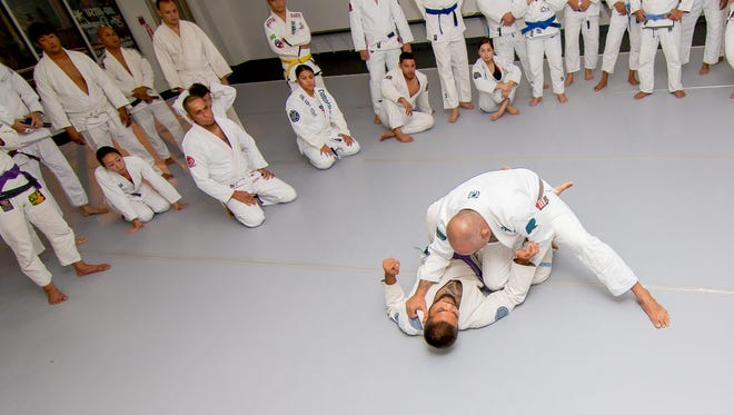 Steve Roberto, chief instructor, demonstrates the finer details of the techniques in jiujitsu at their Purebred Jiu Jitsu Academy in Hagåtña on Aug. 31. Virgilio Valencia/For Pacific Daily News