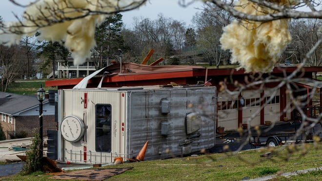An RV is turned over next to a damaged garage on Wednesday, March 22, 2017, in Hixson, Tenn., after Tuesday evening storms caused isolated damage throughout the region.  More severe storms are forecast to fire up across the southern U.S. over the next few days.