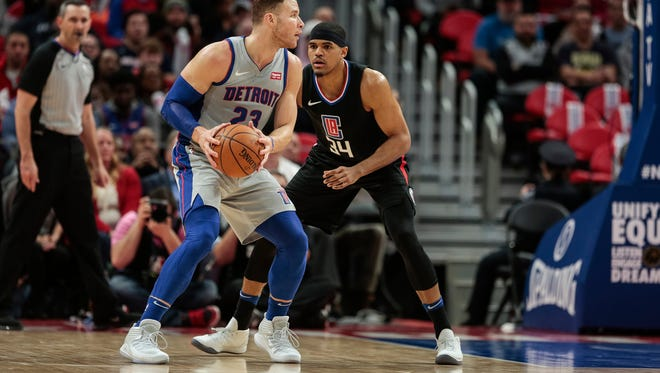 Pistons forward Blake Griffin (23) is defended by Clippers forward Tobias Harris (34) during the first half at the Little Caesars Arena in Detroit, Friday, February 9, 2018.