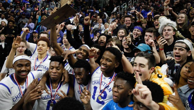 Southfield Christian celebrates Christian's 64-54 win in the Class D state title on Saturday, March 24, 2018, at Breslin Center.