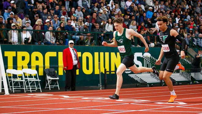 West Salem's Jacob Miller crosses the finish line just ahead of Tigard's Braden Lenzy in the 6A boys 400 meter dash at the 2018 OSAA Track and Field State Championships on Saturday, May 19, 2018, at Hayward Field in Eugene. Miller took first with a time of 47.45.