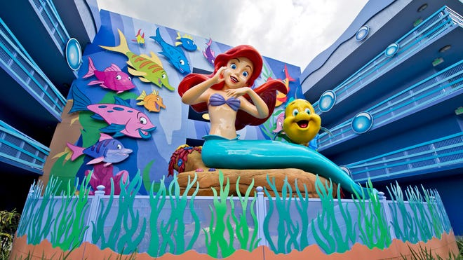 """Surrounded by Flounder and friends, a larger-than-life Ariel overlooks """"The Little Mermaid"""" courtyard."""