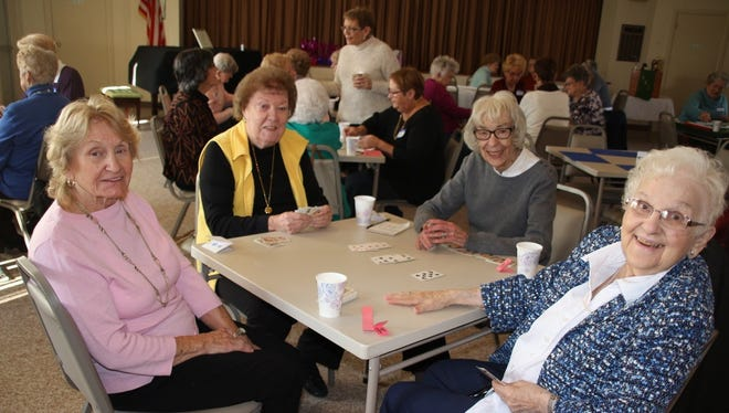 (From left) Irene Bird, Shirley Selfridge, Mary Etta Wolf and Lucille Reger enjoy a game of bridge during the Millville Woman's Club's Winter Game Day and luncheon.