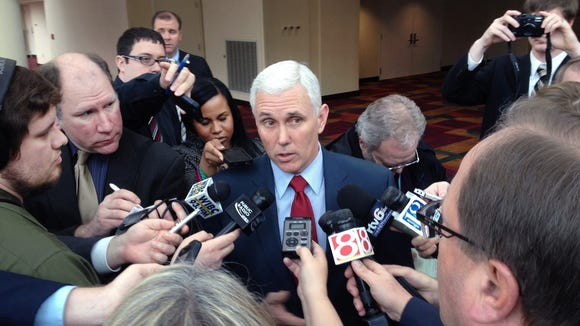 The news media interviews Ind. Gov. Mike Pence
