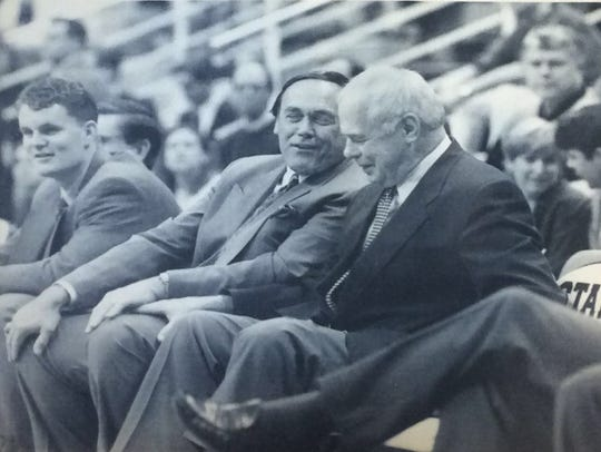 MSU basketball coach Jud Heathcote shares a laugh with