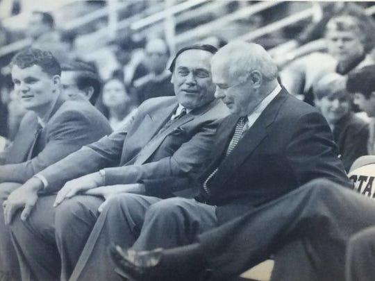 MSU basketball coach Jud Heathcote shares a laugh with good friend Gene Keady, Purdue head basketball game, before their game, February 1995.