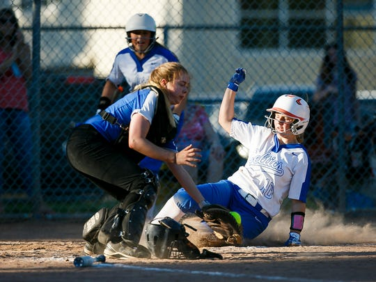 McNary's Haley Bingenheimer slides into home for another run against Grant High School in the first round of the OSAA 6A state playoffs on Monday, May 22, 2017, at McNary High School in Keizer, Ore. McNary defeated Grant 18-14.