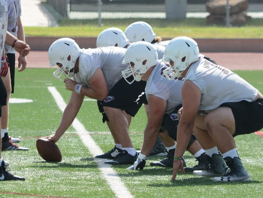 The McMurry offensive line stays set before the snap