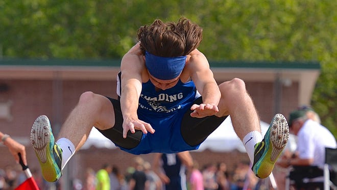 Reading's Justin Dreyling competes in the long jump during the Ohio Track and Field State Championship in Columbus.