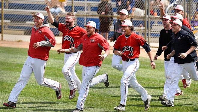St. Cloud State players clear the bench and meet on the infield after the final out against Concordia to win the Northern Sun Intercollegiate Conference championship game Sunday, May 15, at Joe Faber Field in St. Cloud.