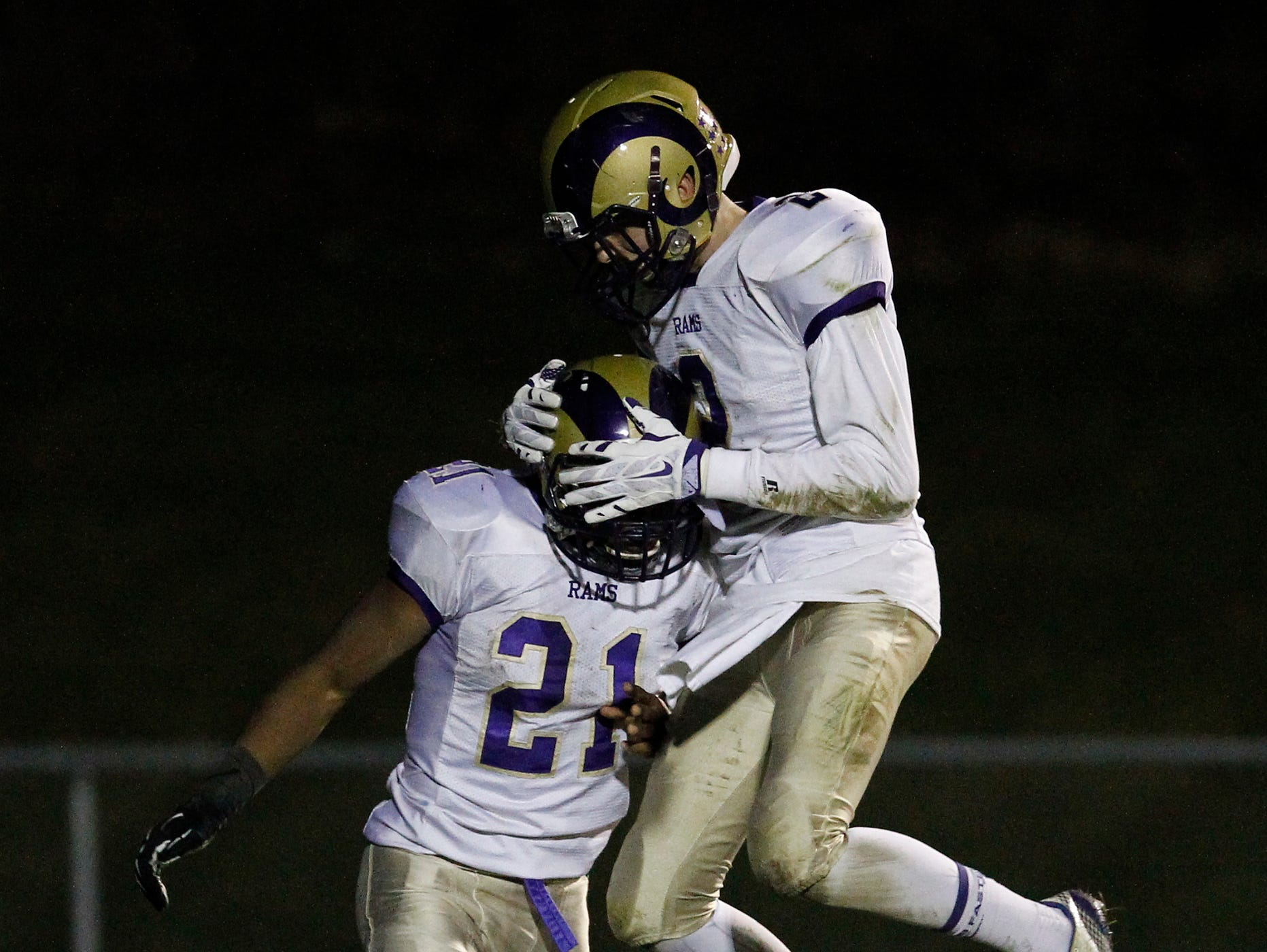 Clarkstown North's JR Levy (21) and Kevin Sheridan (2) react to a touchdown during their 21-7 loss to John Jay High School in the class AA semi-final football game in East Fishkill on Friday, Oct. 30, 2015.