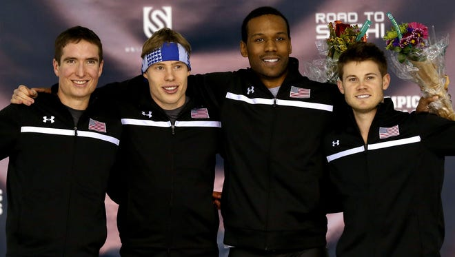 Jonathan Kuck, Brian Hansen, Shani Davis and Joey Mantia celebrate on the medals podium after the men's 1,500 meter during the U.S. Speed Skating Long Track Olympic Trials at the Utah Olympic Oval on December 31, 2013 in Salt Lake City, Utah.