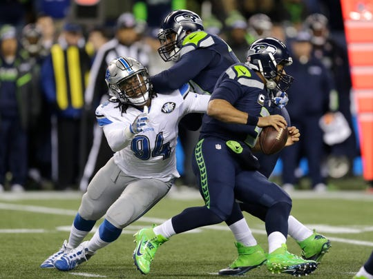 Lions defensive end Ziggy Ansah pressures Seahawks