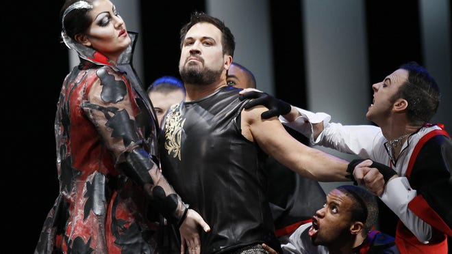In this Feb. 24, 2012 file photo, David Daniels, second from left, performs as Rinaldo, during the final dress rehearsal at the Lyric Opera of Chicago's production of Rinaldo. Police have arrested Daniels, a renowned opera singer and University of Michigan professor, on allegations that he and his husband in 2010 sexually assaulted a singer in Houston.
