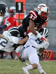 Palm Springs' Joshua Barlow carries the ball during the first half of the game against Redlands in Palm Springs on Friday night, September 4, 2015.