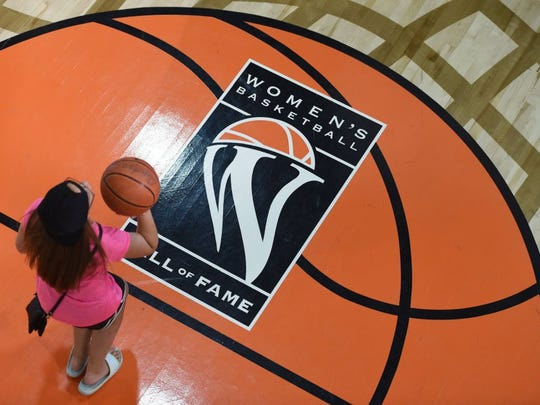 Fans shoot basketball during an autograph session for the 2016 class of inductees at the Women's Basketball Hall of Fame in Knoxville, Saturday, June 11, 2016.