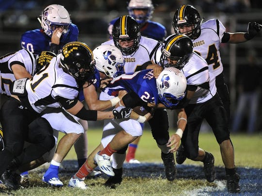 Thomas Metthe/Reporter-News Coleman running back Trotter Harris (23) is pulled down for a short gain by Cisco defenders during the second quarter of Cisco's 42-21 win on Friday, Oct. 14, 2016, at Hufford Field in Coleman.