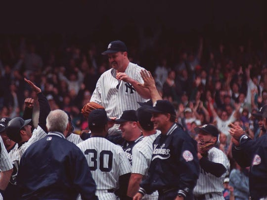 David Wells is carried off the field by his teammates after pitching the first regular-season perfect game in Yankees franchise history on May 17, 1998.