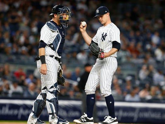 New York Yankees catcher Austin Romine (28) talks to