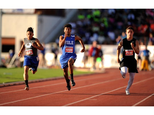 Rule's Chase Thompson, center races to the finish in the Class 1A boys' 100 meters during the 2017 UIL State Track and Field Championships  in Austin. Thompson won the race with a time of 11.09.