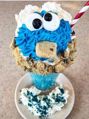 The Orangetown Classic Diner's Cookie Monster milkshake is served in a vanilla frosted glass with chocolate chip cookie crumbles, blue vanilla cookie dough milkshake and topped with the diner's  house-made Cookie Monster butter cookie. $12.50.