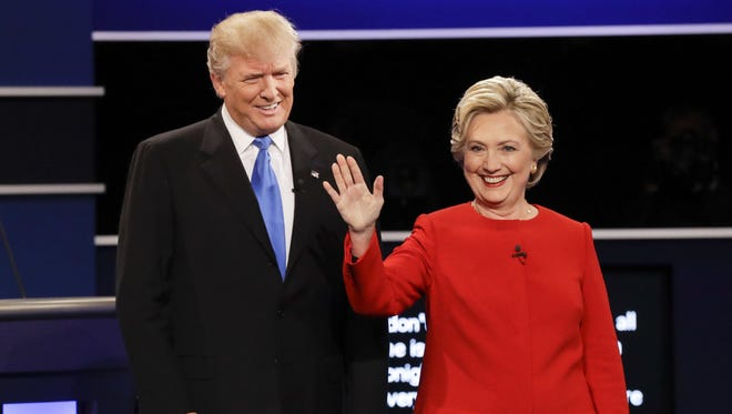 Republican presidential nominee Donald Trump and Democratic presidential nominee Hillary Clinton are introduced before their debate Sept. 26, 2016, at Hofstra University in Hempstead, N.Y.